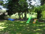Swings and slides in La Chouette garden