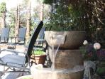 Patio with seating & water feature, relax, read a book and sip a  glass of wine while the sun sets