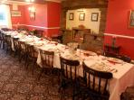 Lage dining room with tables which can be arranged separately or together for a large table.