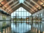 Crystal clear water, double height vaulated ceiling, luxury heated indoor pool of the onsite spa