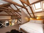 The mezzanine - the double bed is tucked behind a small partition out of view from downstairs