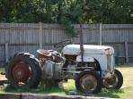 Antique former farm machinery on site
