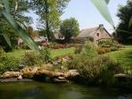 Attractive pond garden with picnic table & secure access