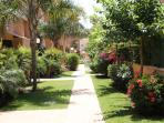 Private secure pathway within the gardens leading to pool area and apartment