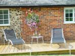 Large decking are with bar b que, loungers, table and chairs
