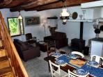 The dining area flows on to a cosy lounge with two leather sofas - a great relaxing spot