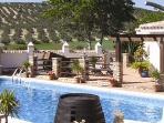 Sunbathing terraces surround the pool