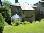 Wellwood Lodge showing the sunny conservatory and back garden