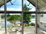 Clearwater 86south facing detached lakeside house with vaulted celing on Lower Mill Estate