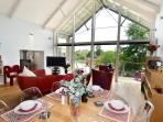 Vaulted Ceiling in the open plan/dining/living with wood burner and uninterrupted lake views