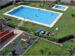 Salt water pool with gardens & sunbeds