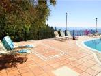Great terrace around the pool with stunning sea view