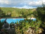 View over the pool towards the 14th Century hunting lodge, in the evening light.
