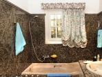A marble  bathroom with home touch