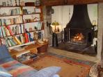 The inglenook fireplace with log burner/open fire