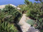 A stonemade staircase leads from the parking to the chalet Le Palmette