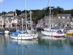 Padstow harbour, home of the 'Obby Oss' and National Lobster hatchery. Catch the ferry from Rock!