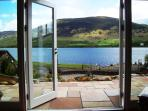 Enjoy views south over Loch Earn and access the patio garden from the 26ft open plan lounge