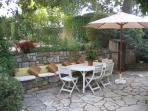 One of several terraces/areas for welcome shaded dining under the oak trees