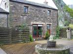 Bracken Cottage, relax on the decking with a glass of wine and enjoy the view.