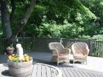 Relax with a glass of wine or a cup of tea on your sunny deck.