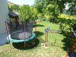 trampoline and swing outside playroom