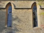 The side of the Chapel with elegant, leaded windows