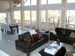 The upstairs, open plan living area is the focal point with an incredible double height ceiling