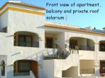 Enjoy your holiday in this first floor apt. complete with private balcony and roof solarium