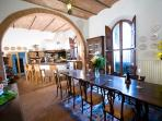 Kitchen and diningroom with an attractive bar and open fireplace,nearby a pantry,in a vault room,WC
