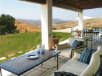 Terrace with sofa and chairs and dining table and chairs