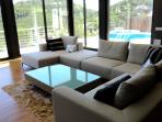 Living room with views of the hills and the private pool