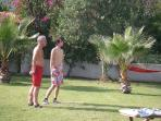Playing boules on the lawn.