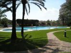 Garden and pool: plenty of space for relaxing and sunbathing; shower, toilets, bar