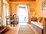 It has 2 balconies where you can stand during the day or night and enjoy Bairro Alto life!