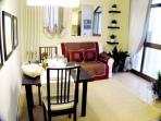 Acqua Suite Apartment Bright & modern living/dining room