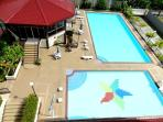Kiddie Pool with Slides, Adult Lap Pool with Huts