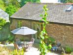 The garden is a real sun trap, complete with barbecue, perfect for alfresco dining