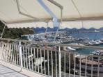 Balcony overlooking Marina with sun blinds