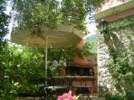 Riza's outdoor dinning area & BBQ corner