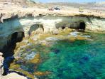 Explore the sea caves at Cape Greco