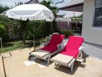 Sun beds, pool towels and umbrellas to relax at he pool.