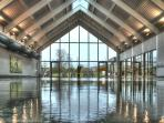Crystal clear water, double height vaulted ceiling, luxury heated indoor pool of the onsite spa