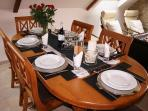 Dining table and settings for dinner for six