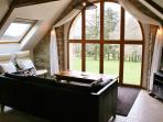 Open views of surrounding countryside from the huge arched window