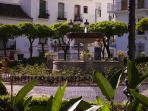 One of the many picturesque squares in Estepona