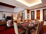 Open plan dining & lounge areas. Teak wooden floors, overhead ceiling fans