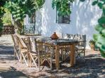 Table under the shade of the Algarrobo trees