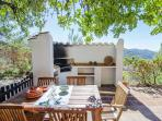 Outdoor kitchen/bbq with dining table