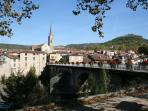 A view across the river towards st antonin noble val .
